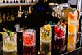 5 colorful cocktails on the bar at Jules Basement