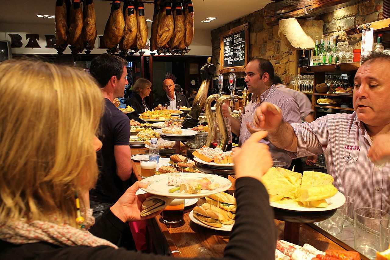 people enjoying Pinxtos at san sebastian restaurant