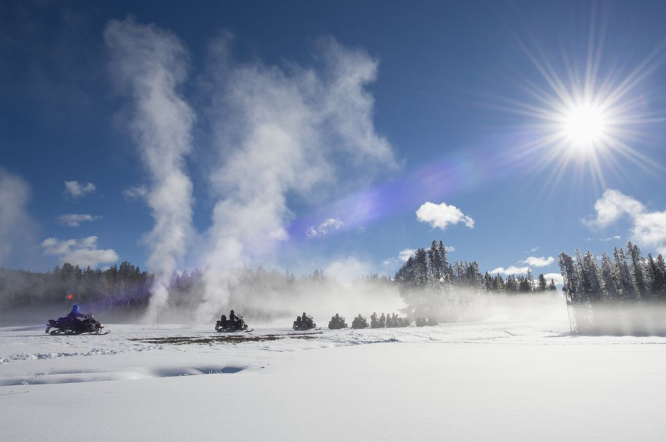 Snowmobiles riding through Fountain Flats, Yellowstone National Park.
