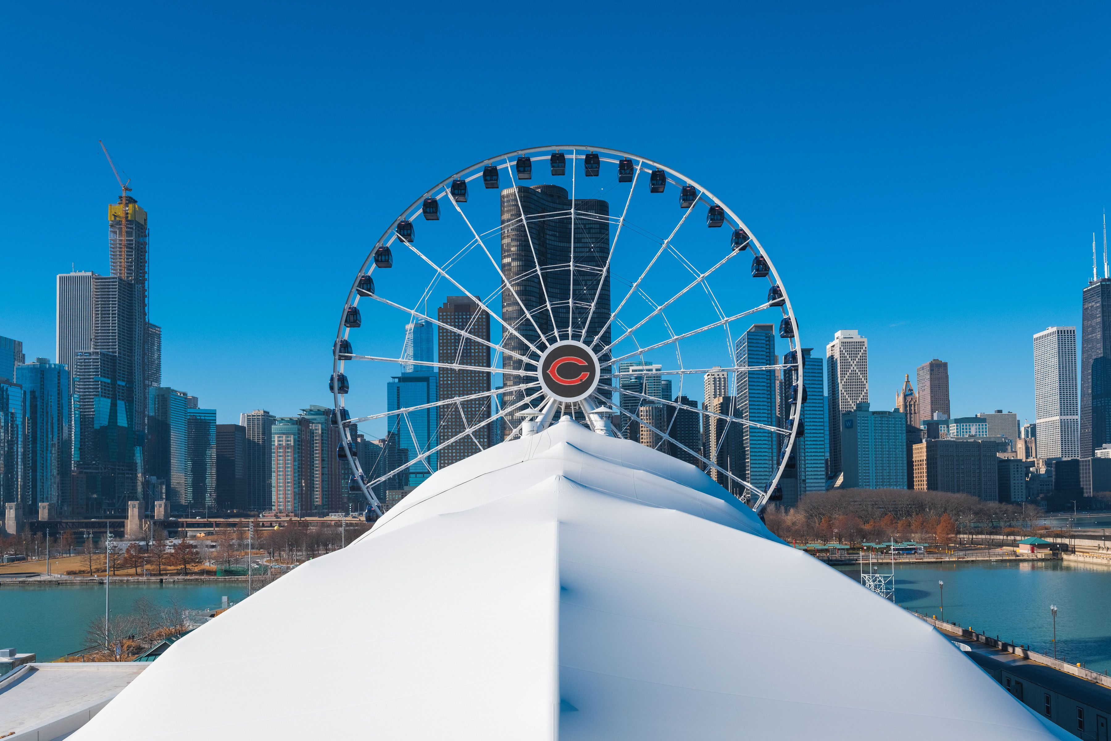 head on view of the Navy Pier ferris wheel with the skyline in the background