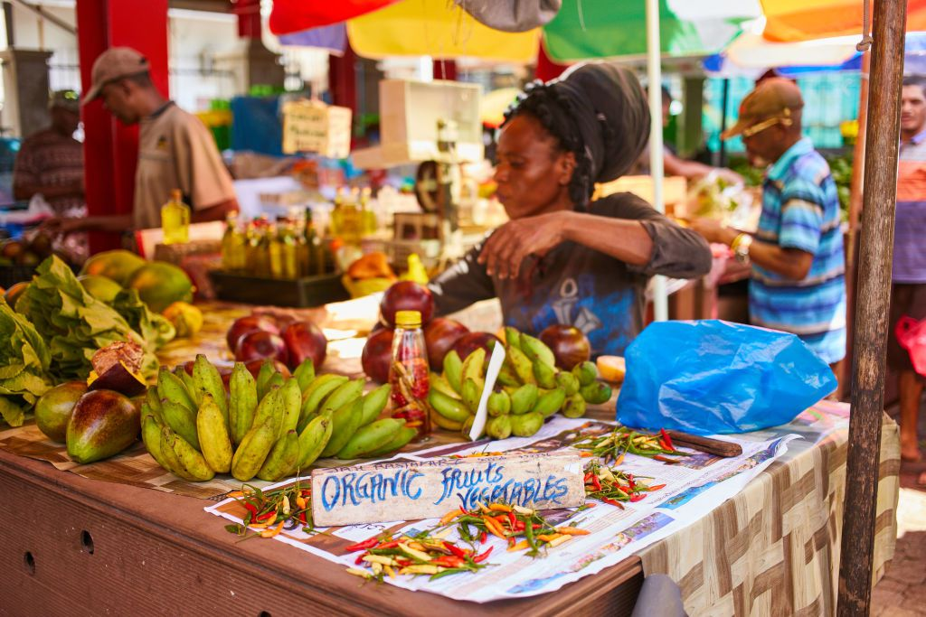 : A woman selling tropical fruits at the local market on May 05, 2017 in Port Victoria, Seychelles