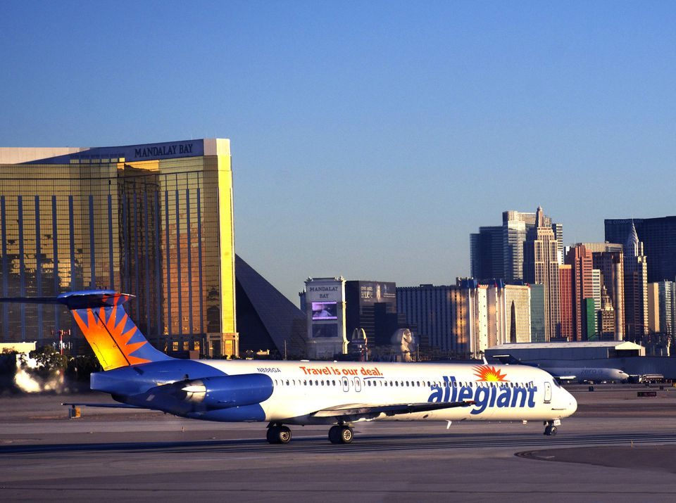 Allegiant airplane on runway with Las Vegas hotels in the background