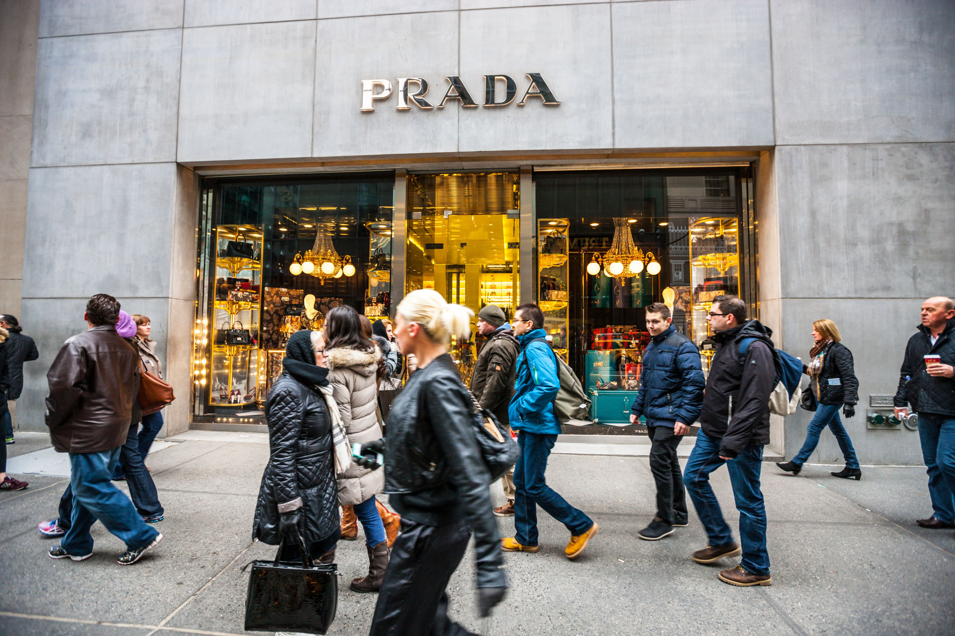 Prada store on 5th Avenue and crowds of people, NYC