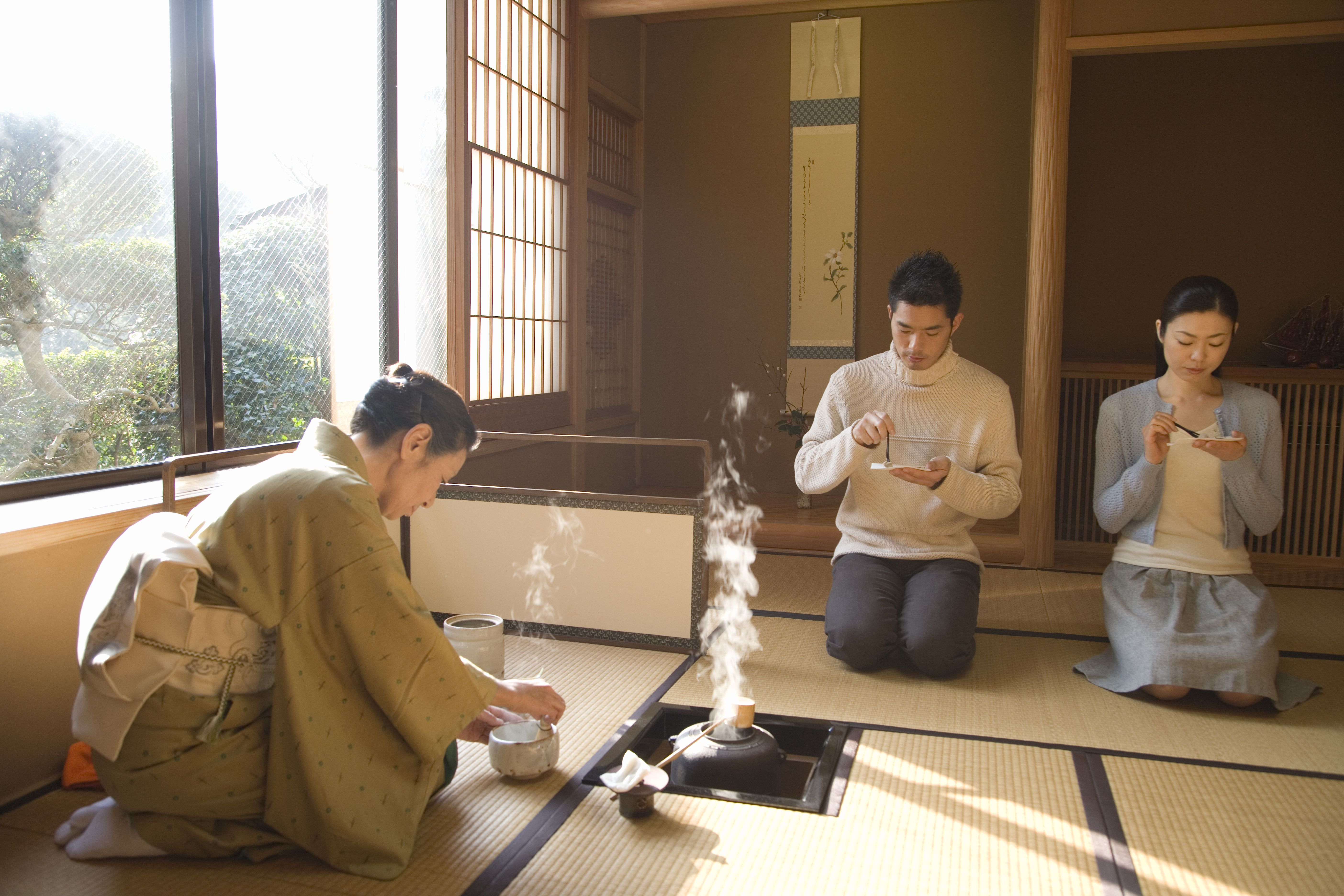 Couple attending Japanese tea ceremony, front view, side view, Japan