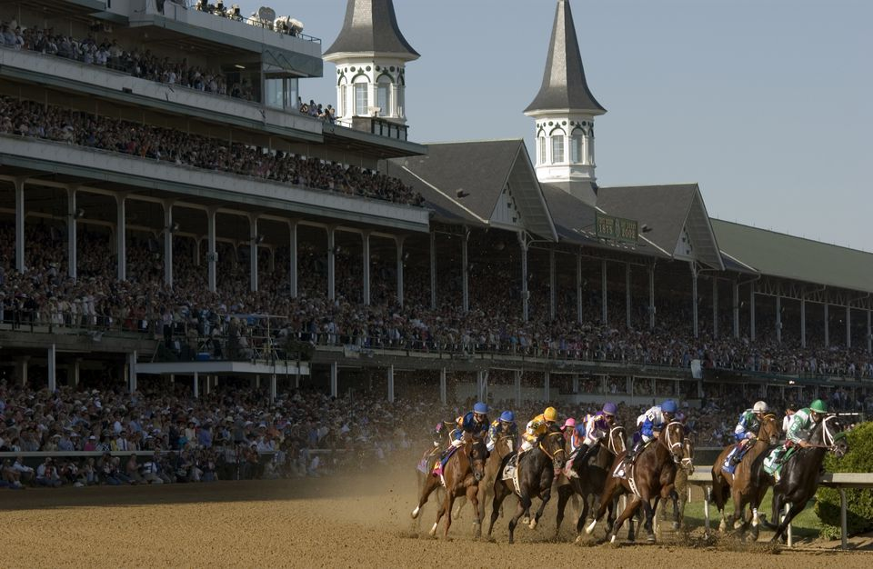 Horses racing at the Kentucky Derby.