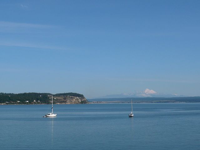 View of Sailboats and Mount Baker from Coupeville on Whidbey Island © Angela M. Brown