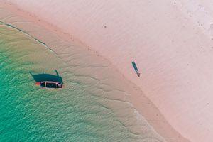 Aerial photo of a traditional dhow on the beach on Mafia Island, Tanzania