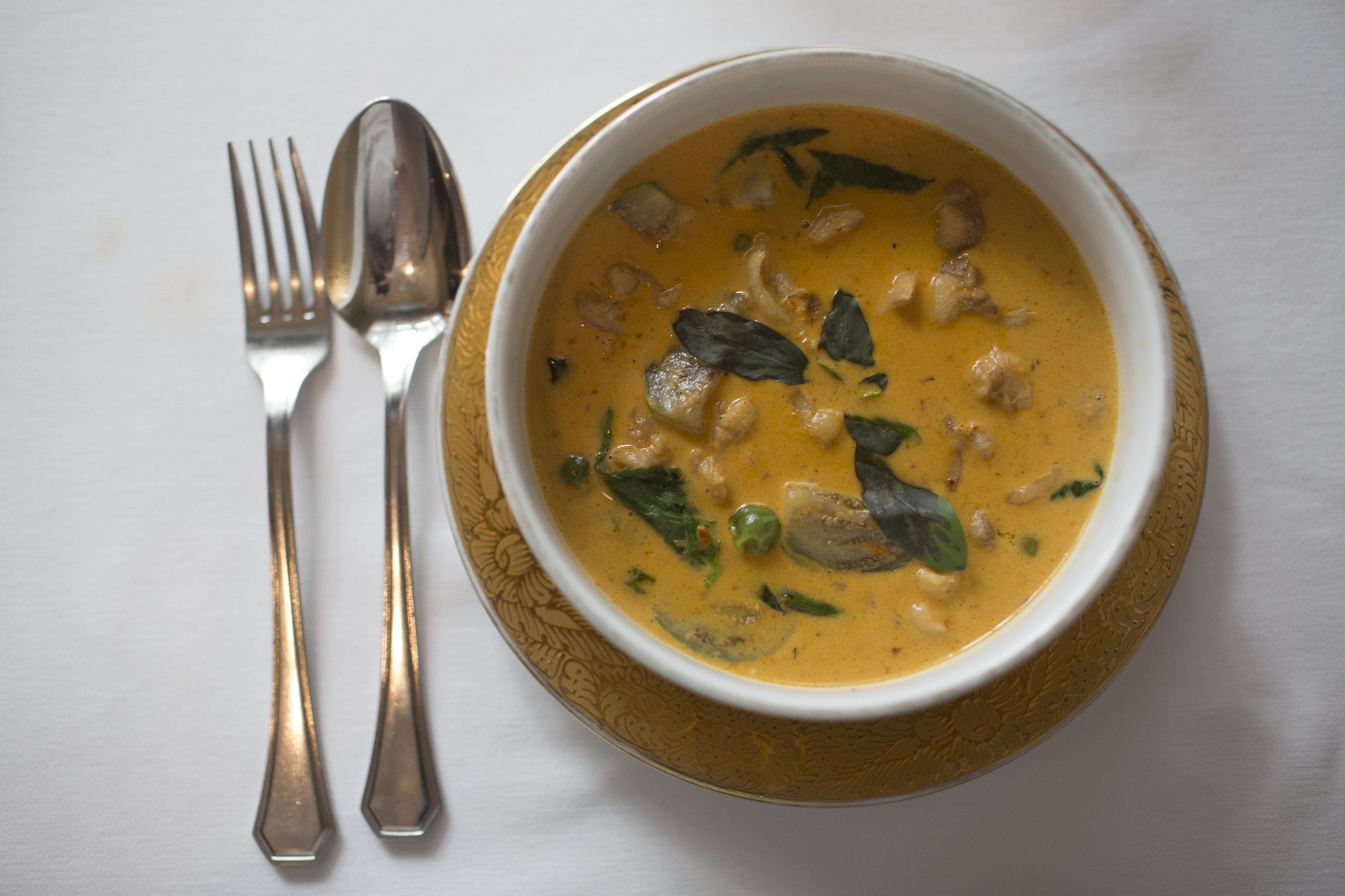 Thai red curry dish served in a restaurant