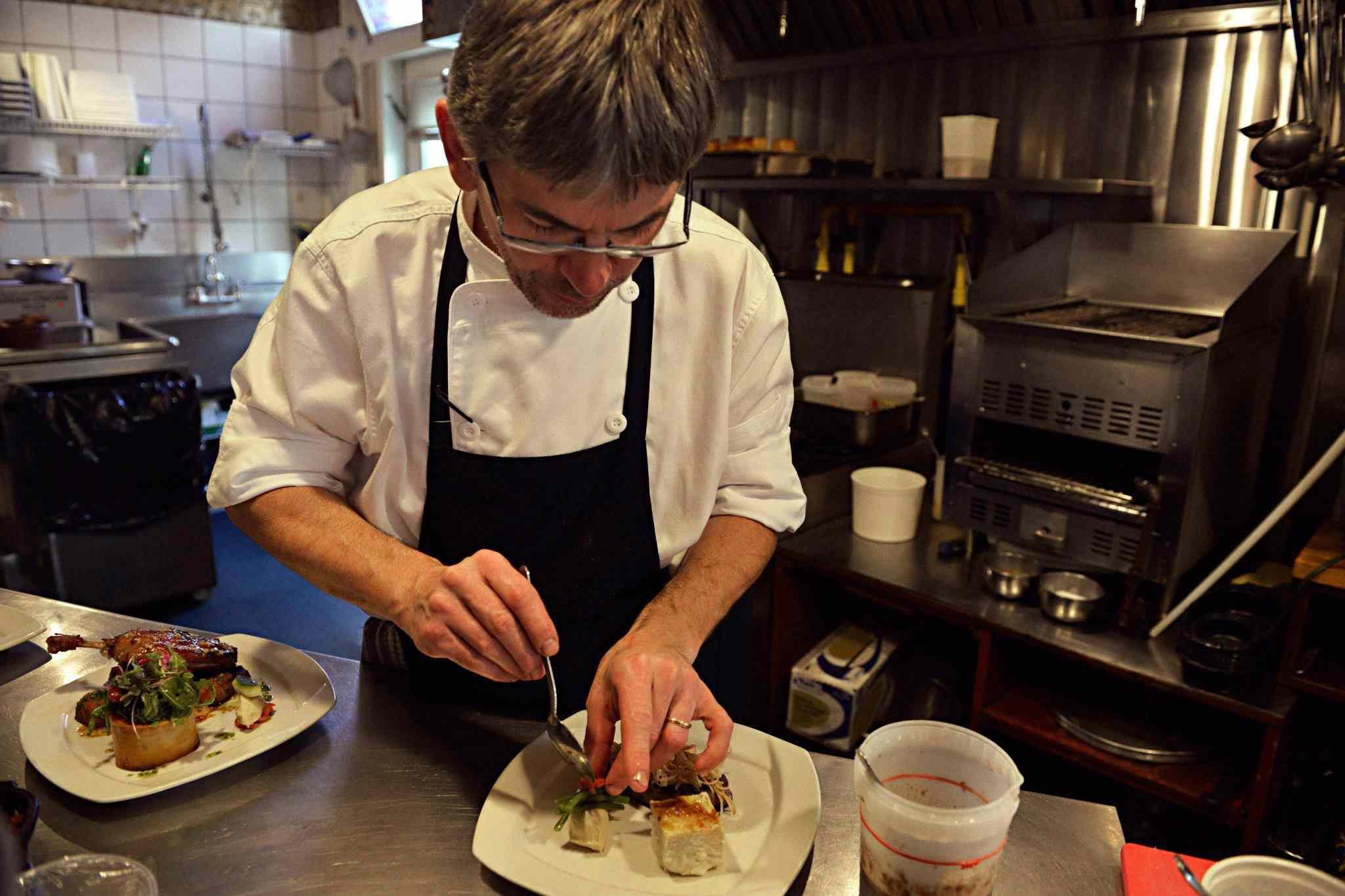 Chef Alain Loivel preparing a dish