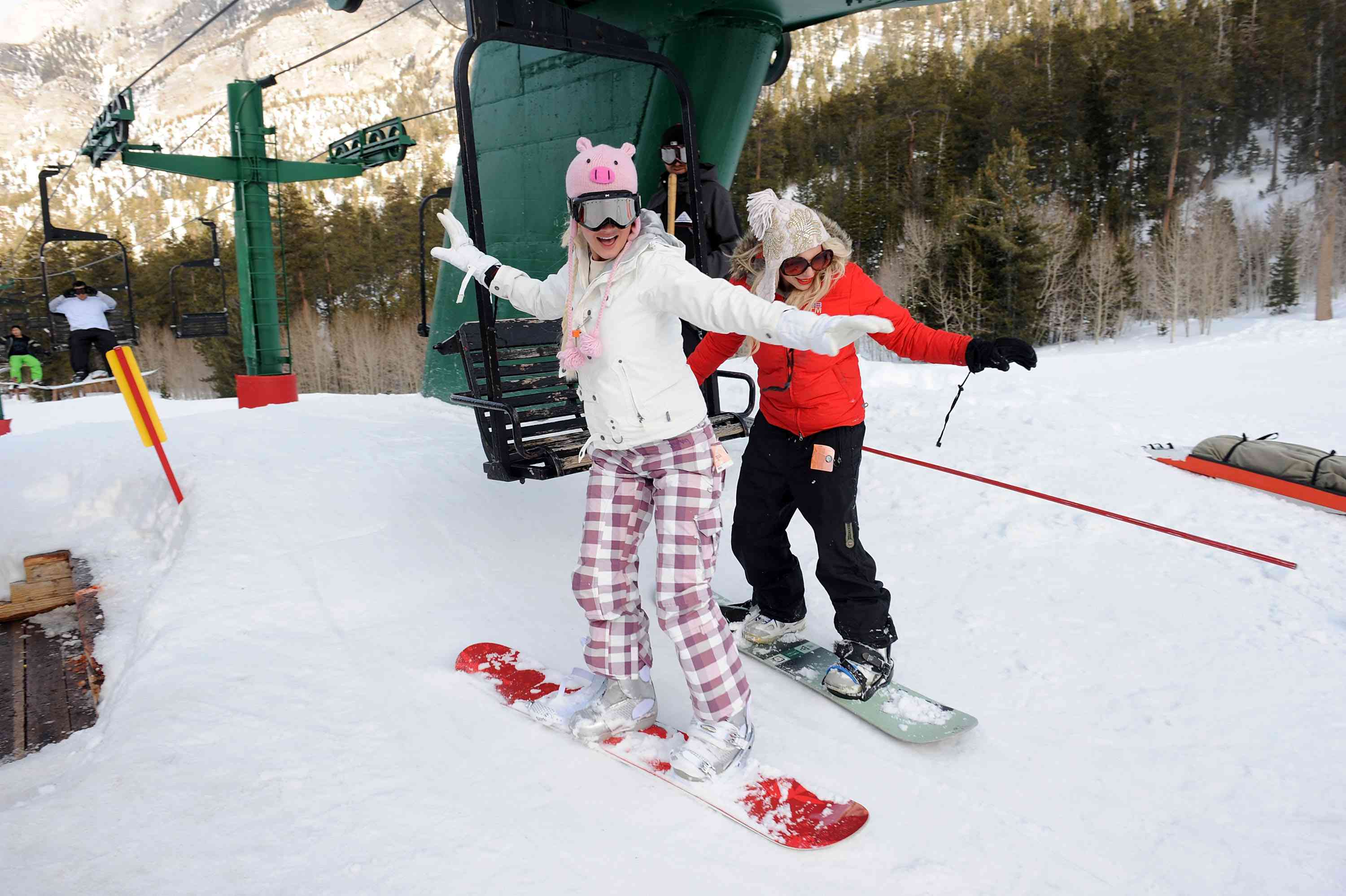 Snowboarders getting off lift at Lee Canyon
