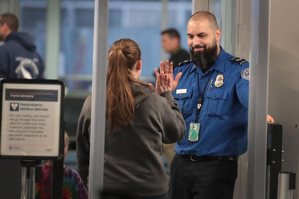 TSA Agents Work At Airport Security