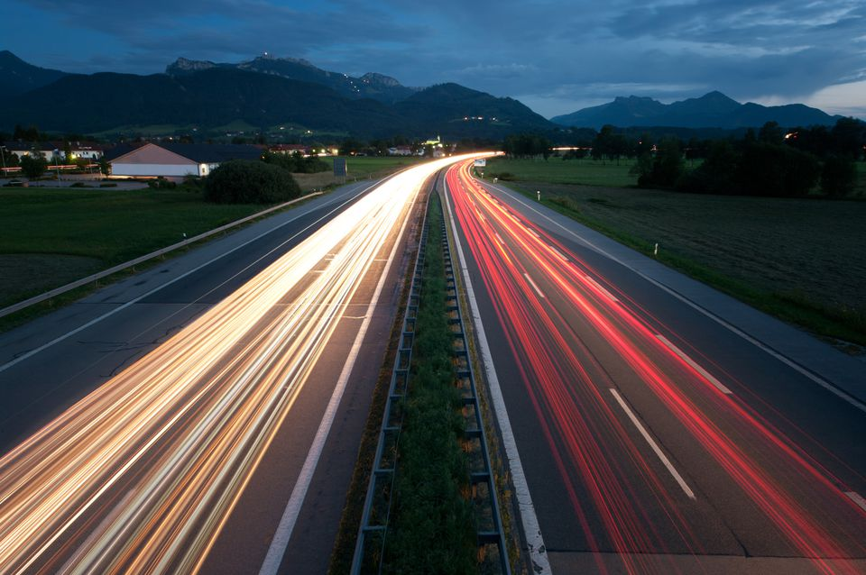 Cars on the Autobahn at night.