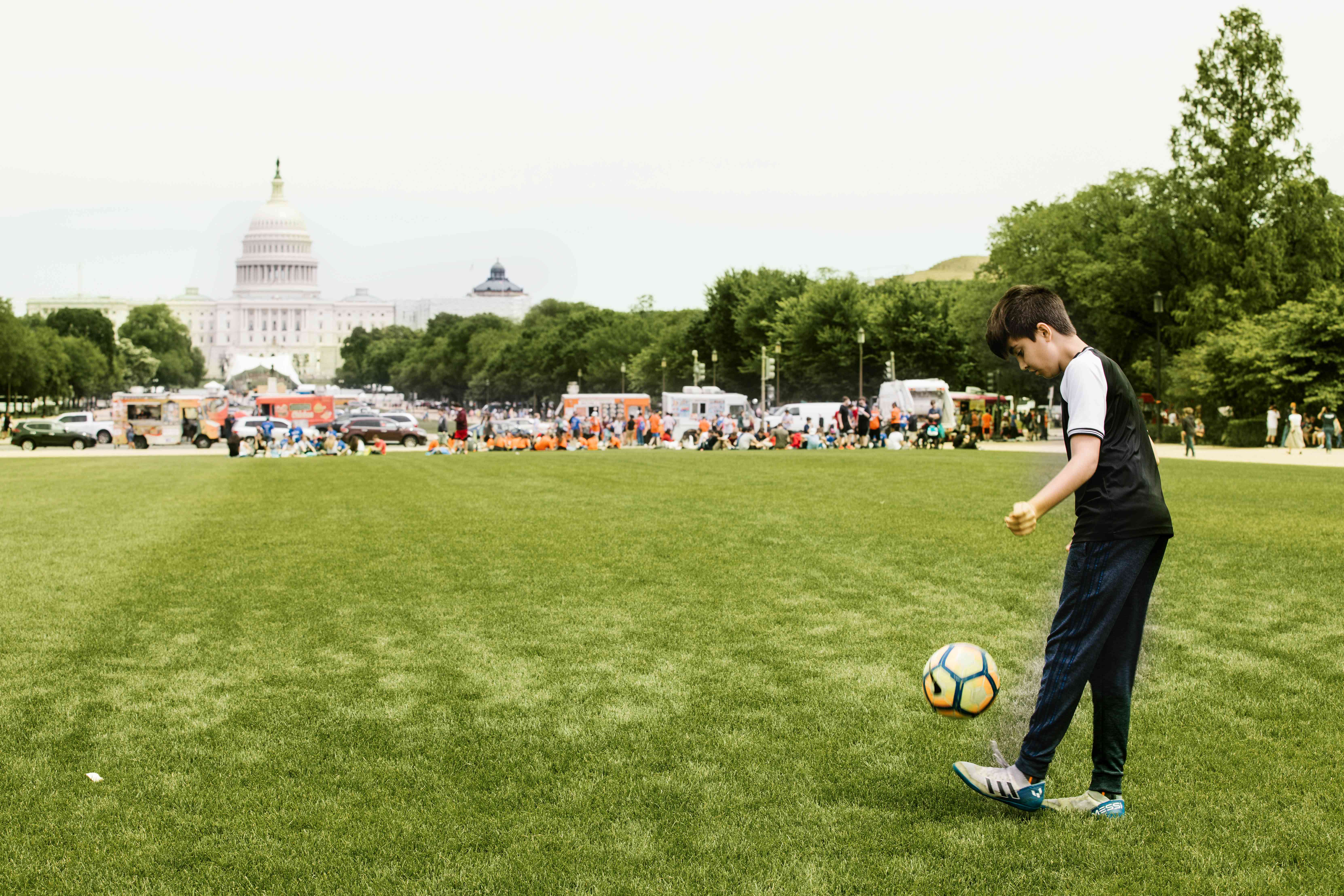 Boy playing soccer on the National Mall