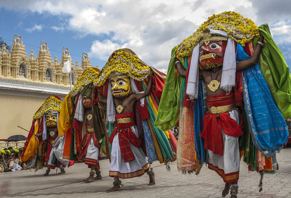 Indian folk dancers performing during a festival procession.
