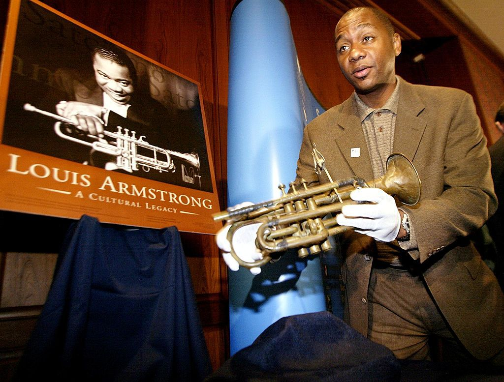 Branford Marsalis holds Louis Armstrong's cornet at the Smithsonian's National Museum of American History