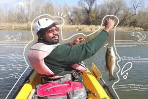 A man holding up a fish while sitting in a kayak. Illustrated white lines emphasize edges