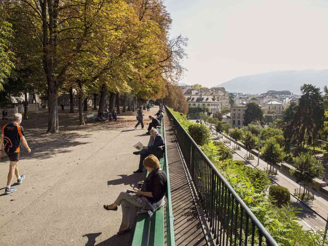 People sitting on the Treille bench on a sunny day