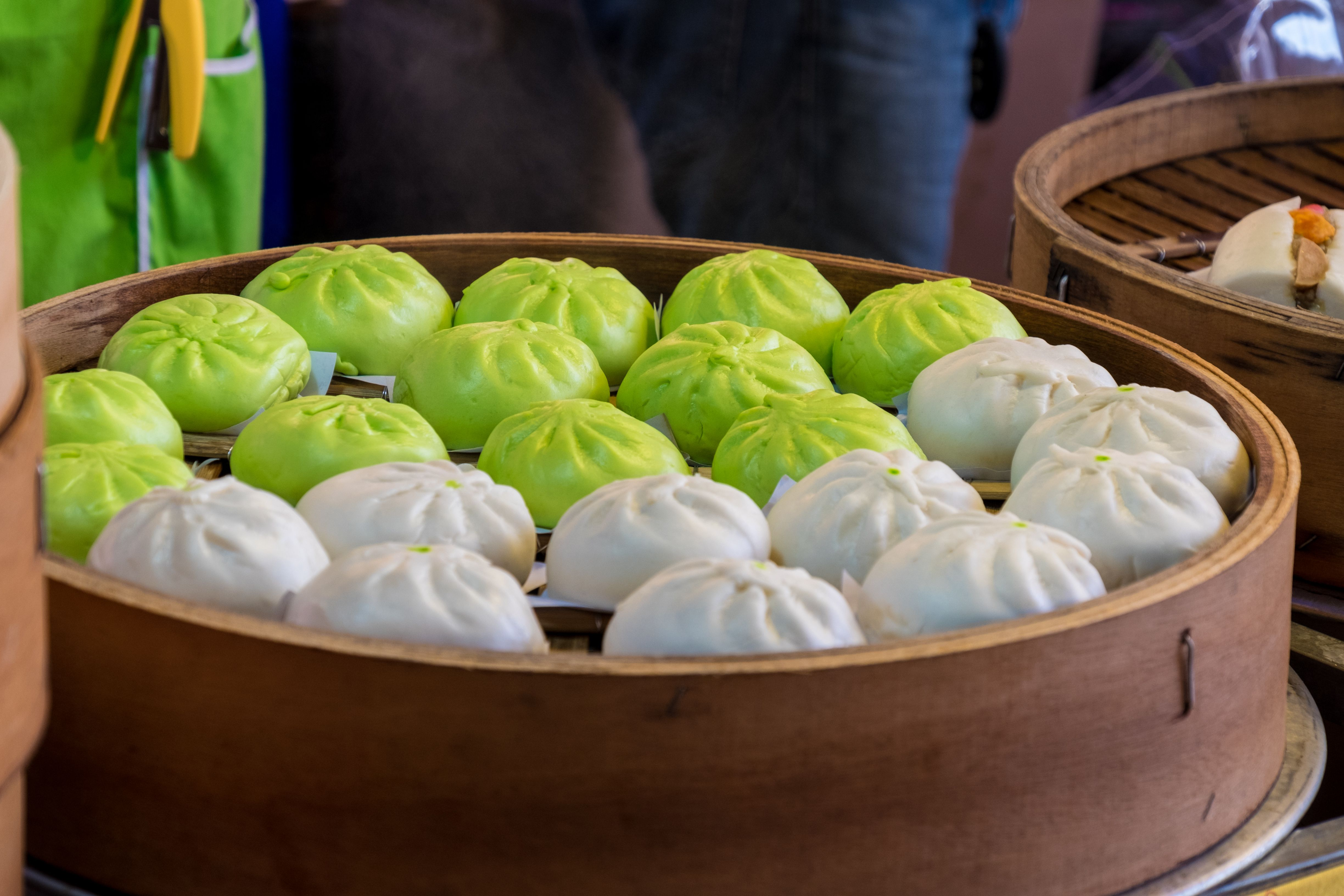 White and green salapao / bao buns in a basket in Thailand