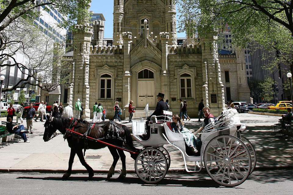 Horse and carriage passing in front of Water Tower.