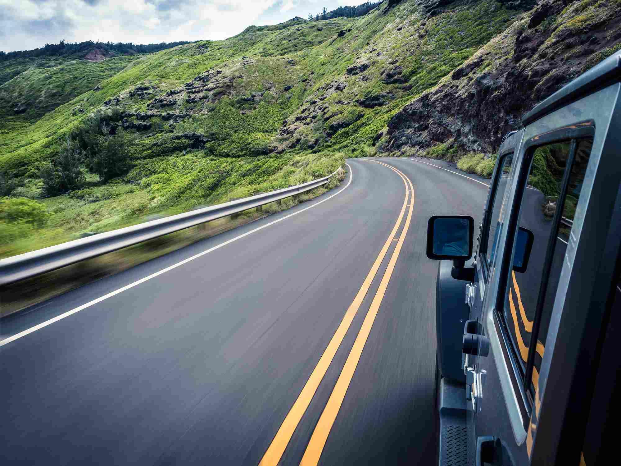 car driving through mountains