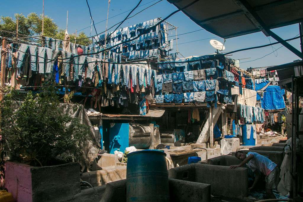 Several lines of laundered jeans hanging up