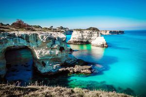 Idyllic Shot Of Rock Formation In Sea At Salento Italy