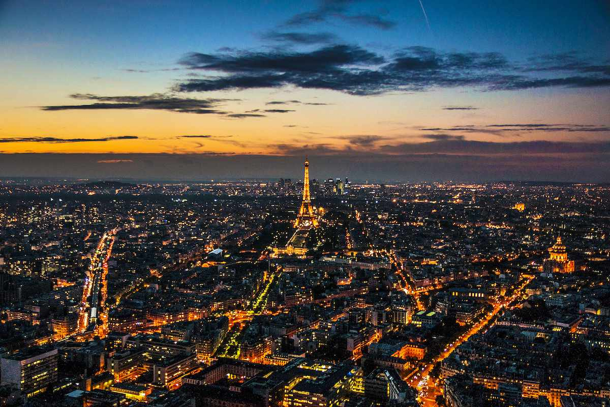 The lights of Paris—including the Eiffel Tower—stretch into the distance