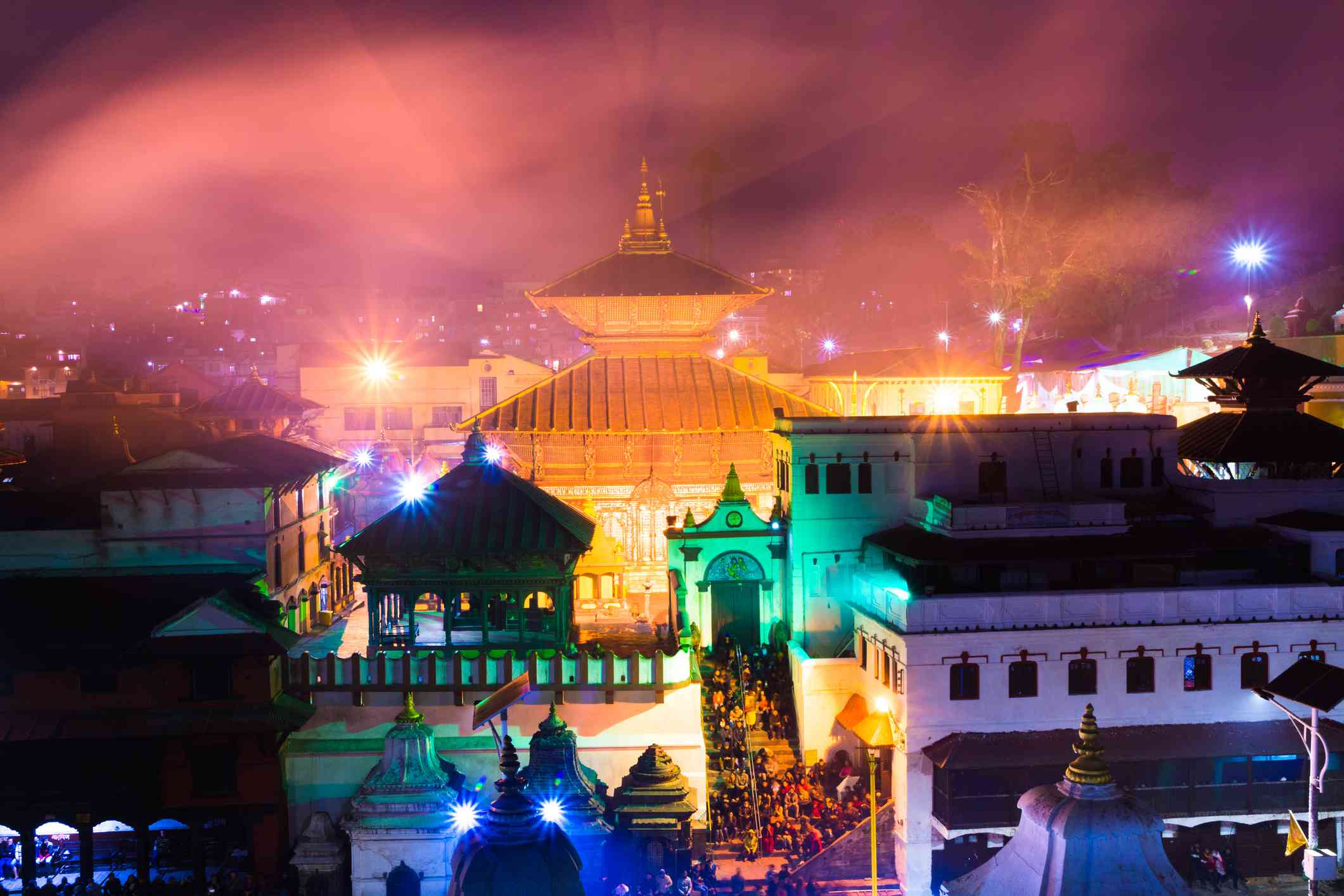 pagoda temples lit up at night with colorful lights