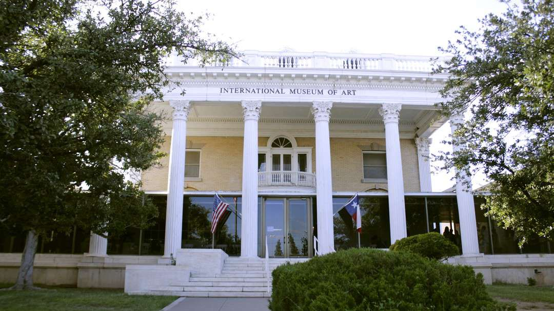 front entrance of a Greek revival-style building that houses the International Museum of Art in El Paso