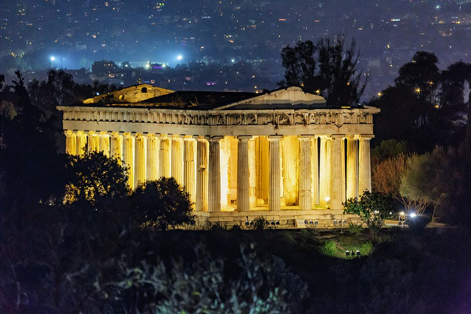 Temple of Hephaestus at Athens lit up at nighttime
