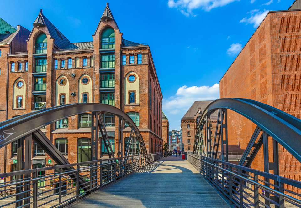 City of Warehouses or Speicherstadt district, Niederbaumbridge bridge and Kehrwiederspitze in Hamburg city