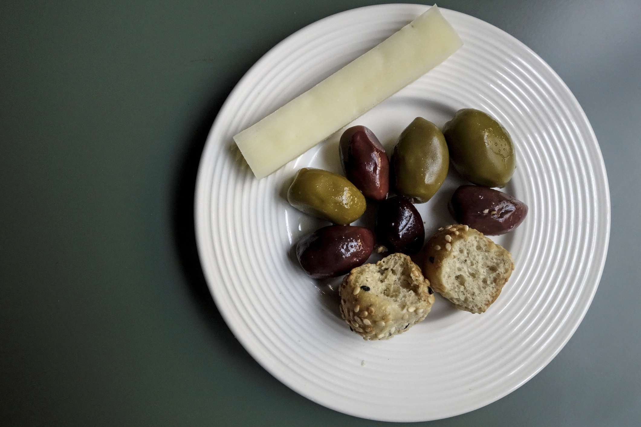 A Simple Meze from Cretre. Olives, Graviera Cheese and small Boukies Paximadia Rusks