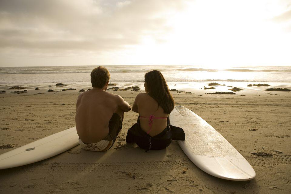 Surfers Watching Sunset on San Diego beach