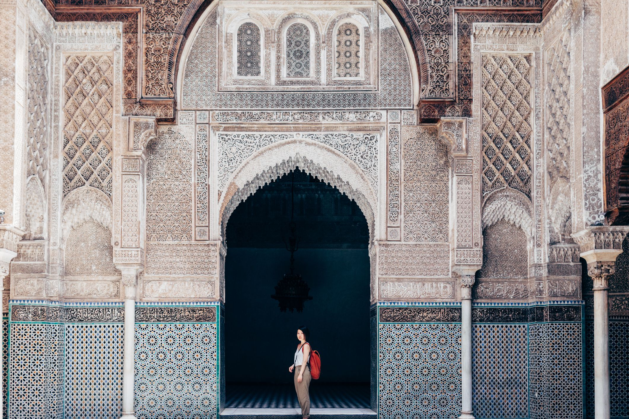 A tourist in an old mosque in Marrakech.