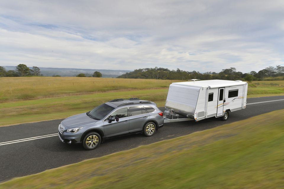 Car towing a camper trailer