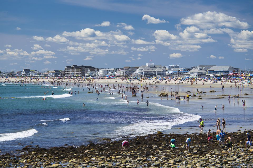 People relaxing on sunny beach, Hampton Beach, New Hampshire, USA