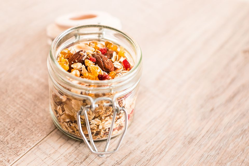 Homemade muesli with oat flakes, dried fruits and nuts in a jar