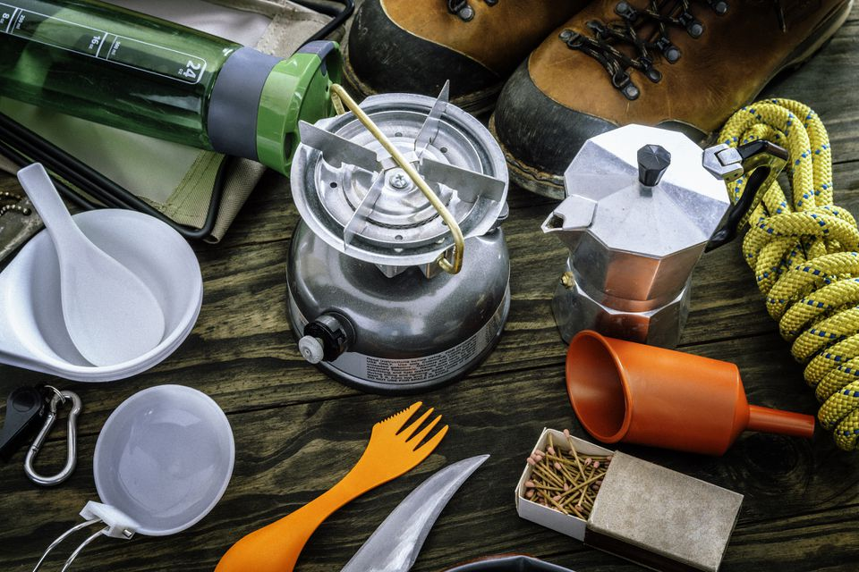 Cooking set . Travel equipment and accessories for mountain hiking trip on wood floor