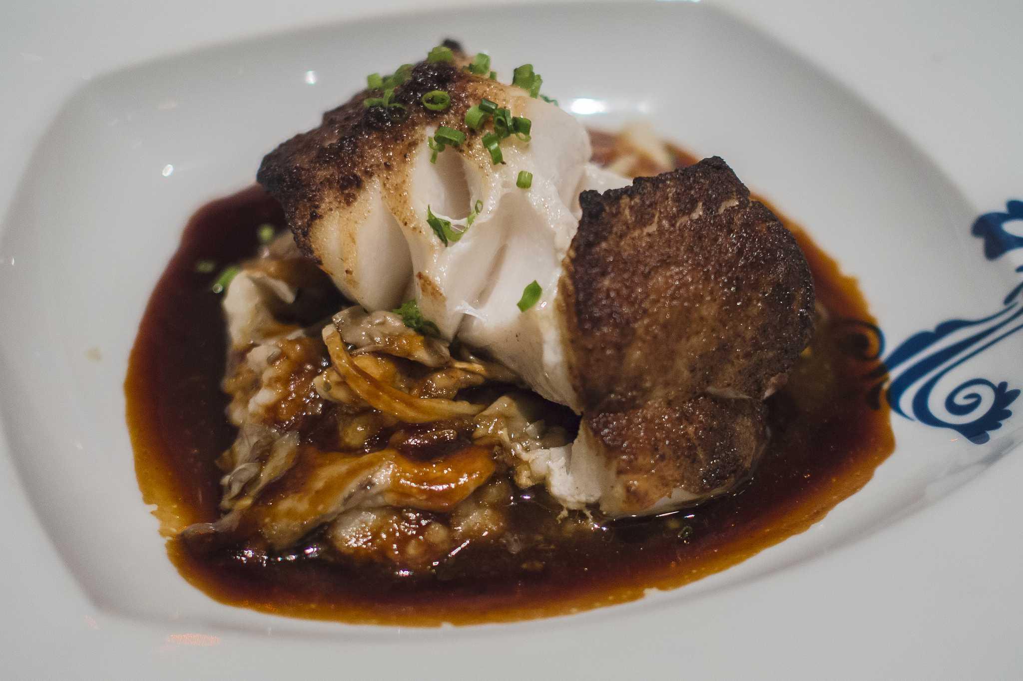 Porcini crusted roasted black cod, port reduction at Ferreira Café