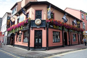 exterior of pink irish pub with flowers