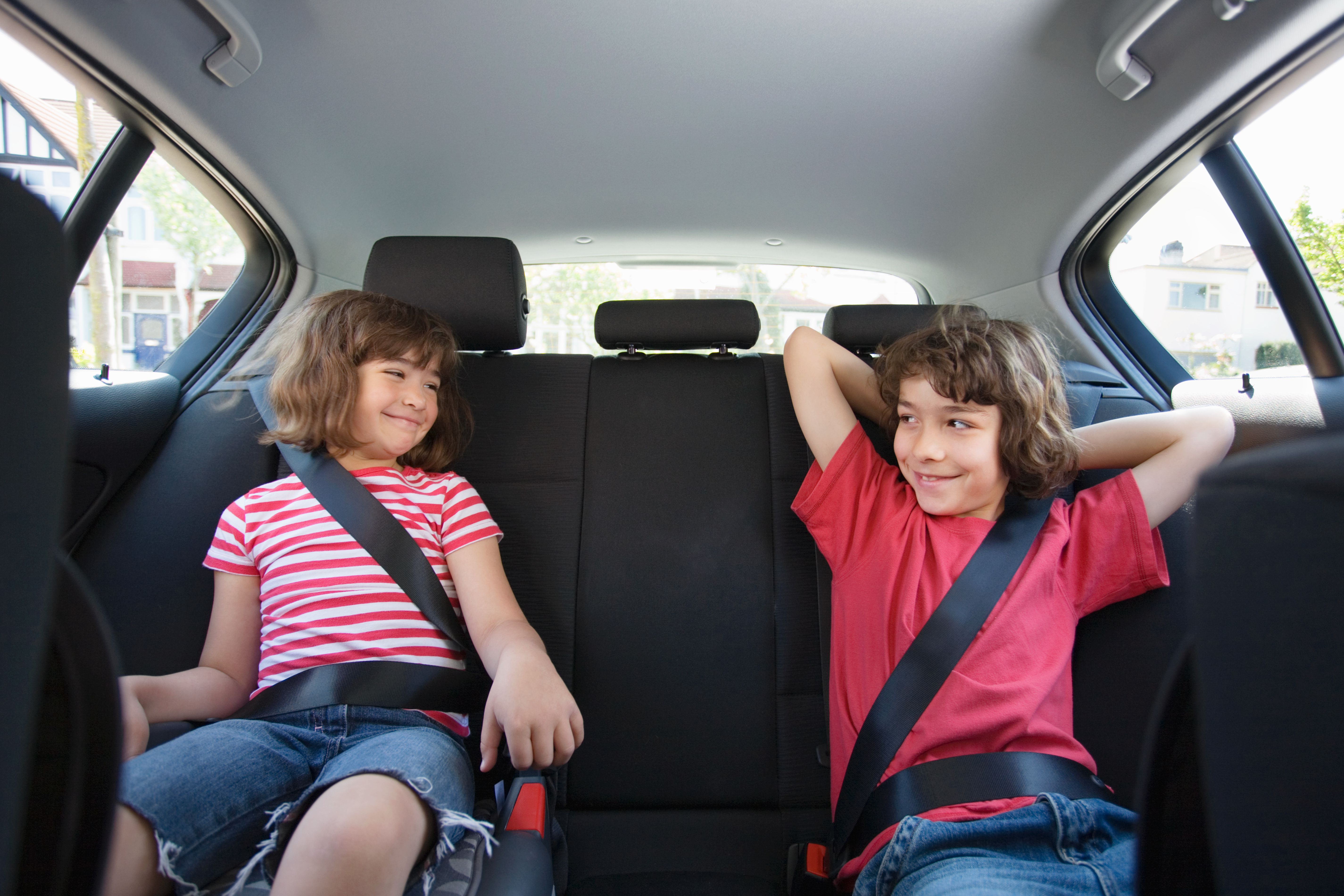 Kids smiling in the car