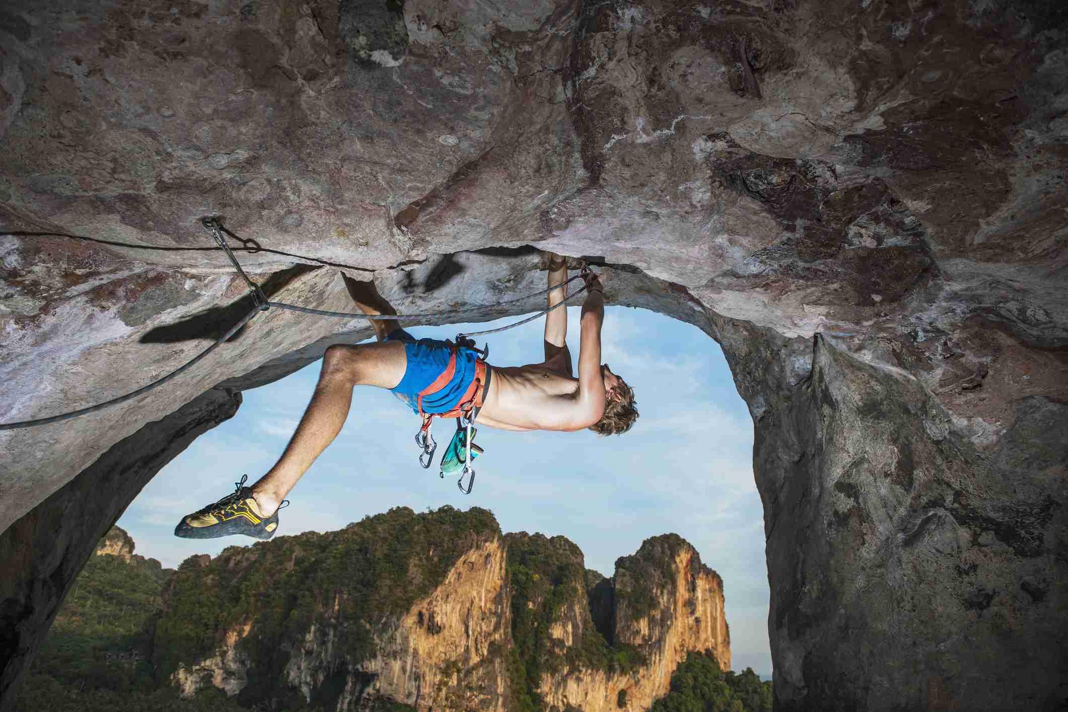 Rock climber climbing on Burnt Offerings, Tonsai, Railay Beach, Krabi, Thailand