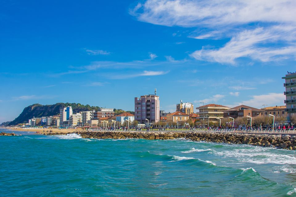 View Of Buildings At Waterfront Against Cloudy Sky in Pesaro, Italy