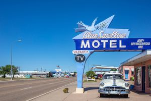 Motel Blue Swallow next to route 66 and an antique pontiac car parked at the entrance. Tucumcari, New Mexico, US.