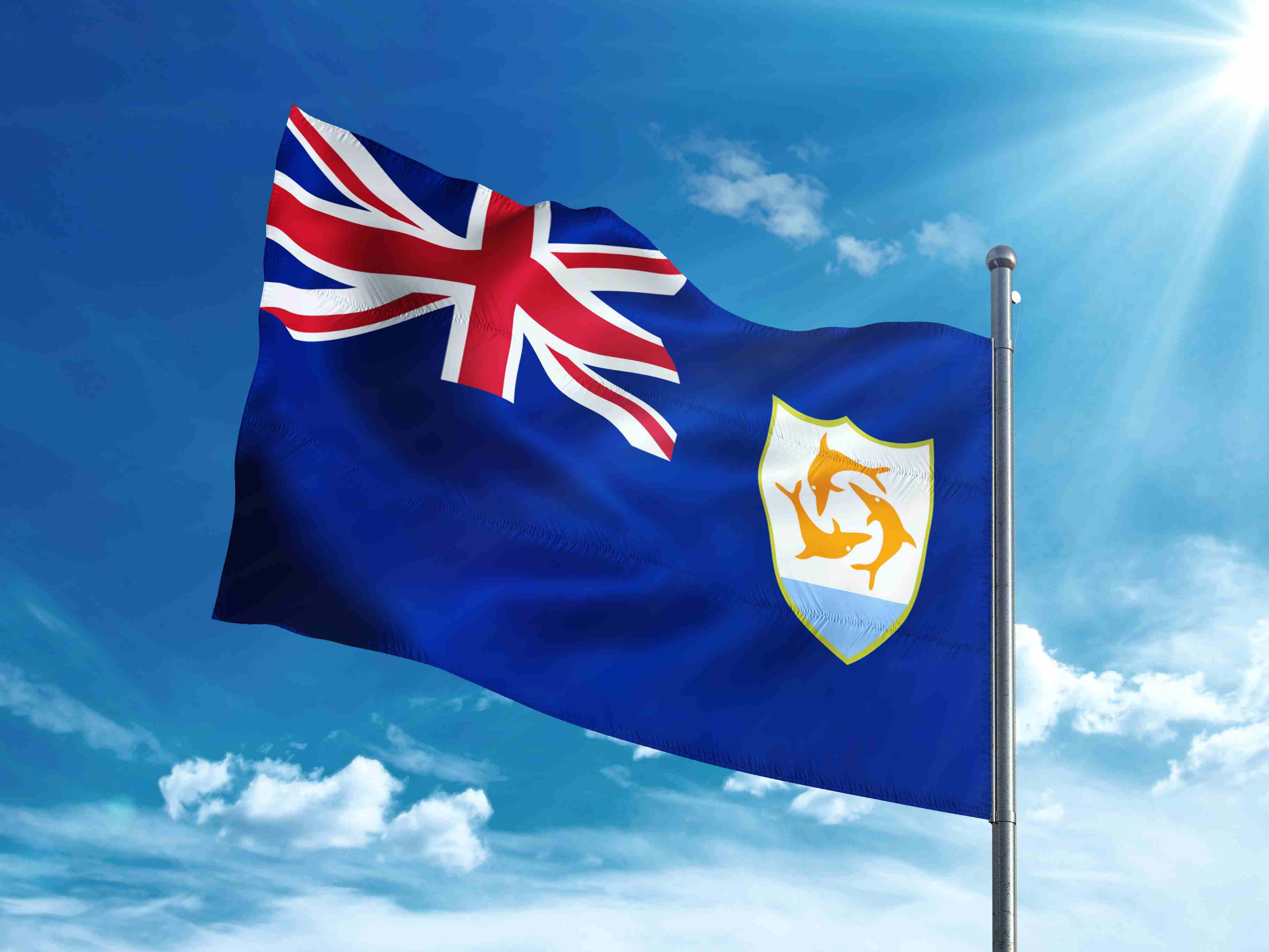 Anguilla flag waving in the blue sky