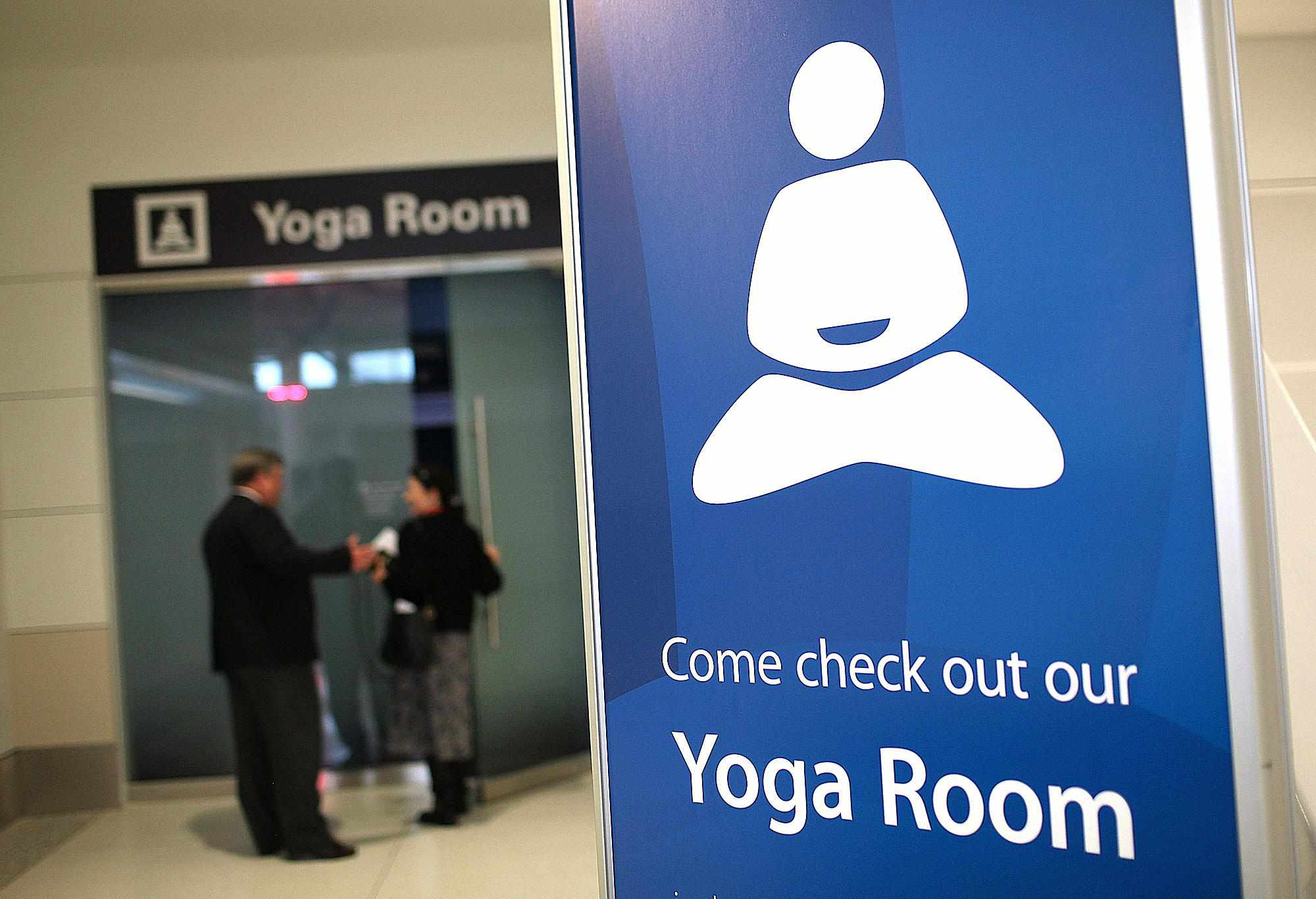 A sign is posted in front of the new Yoga Room at San Francisco International Airport's terminal two