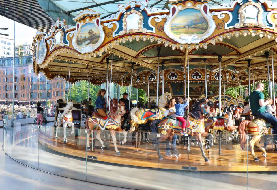 Families riding Jane's Carousel