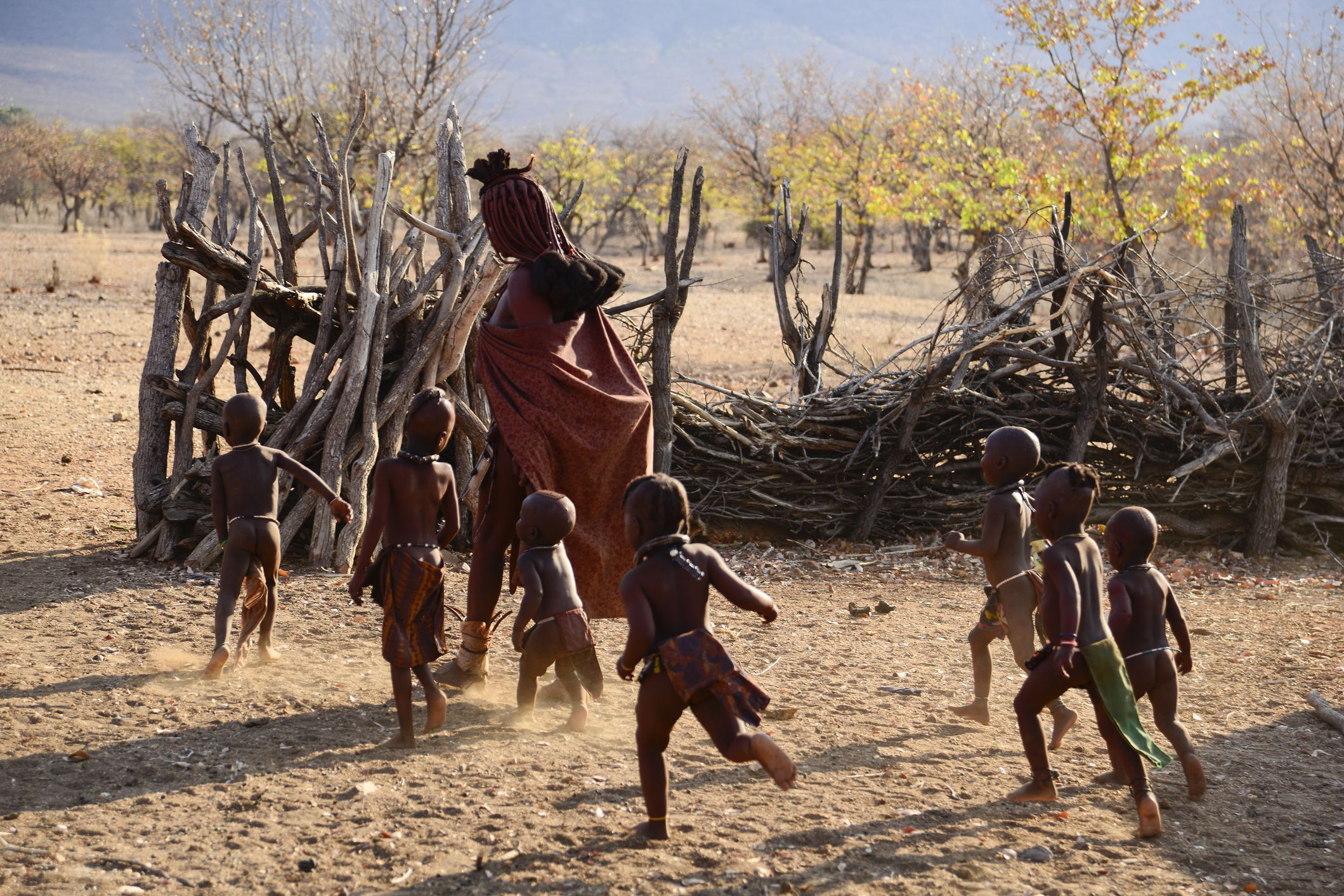 Woman and children in a Himba village, Namibia