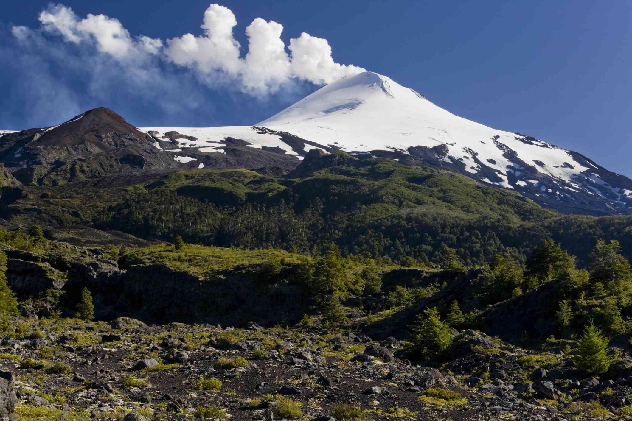 Smoke and vapor rises from active Villarrica Volcano, Sendero de las Cascadas, Andes, Villarrica National Park, Chile