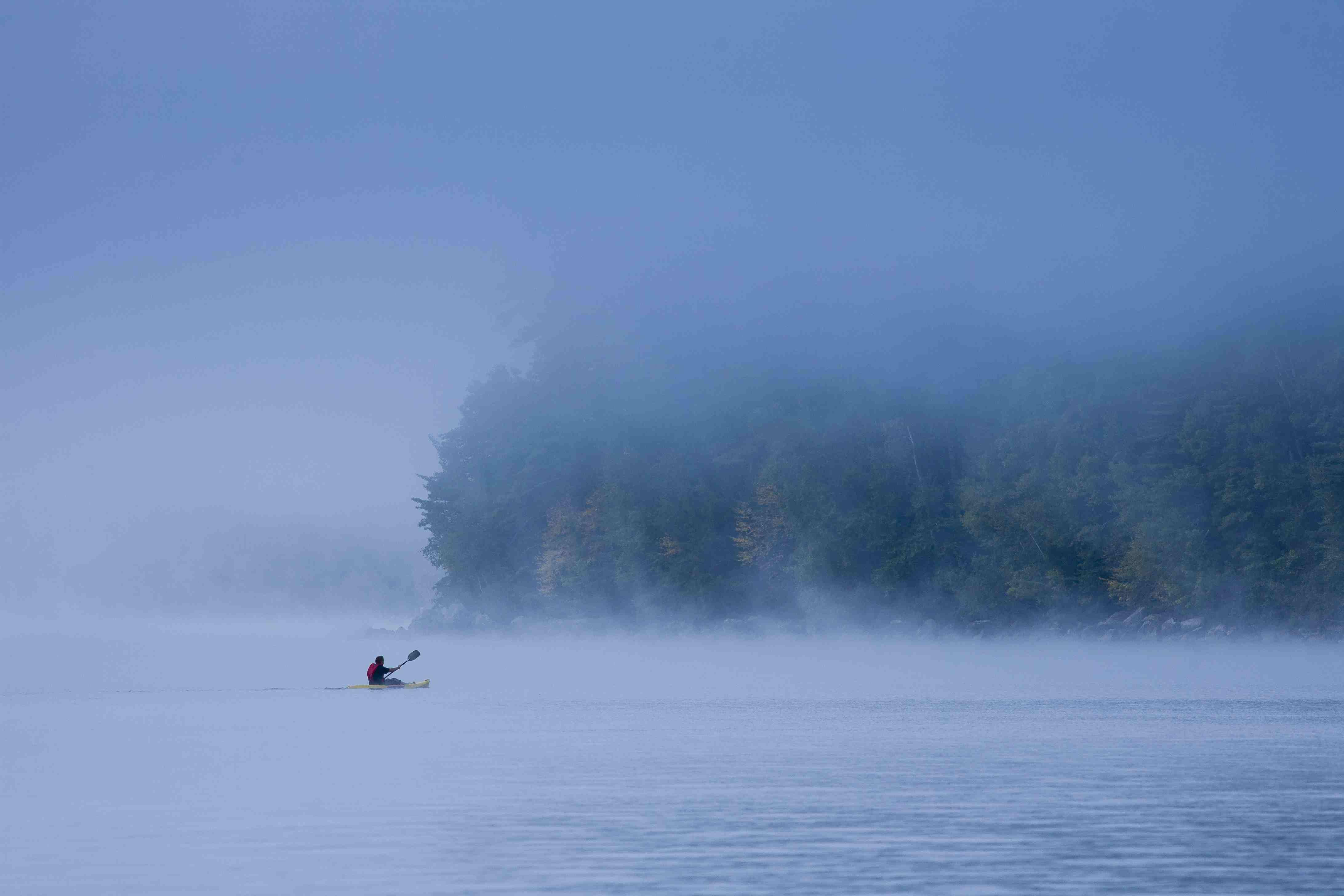 A kayaker on Lake Sebago in Maine.